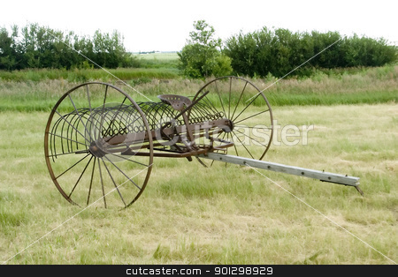 Old Rake stock photo, An old rake on the prairie by Tyler Olson