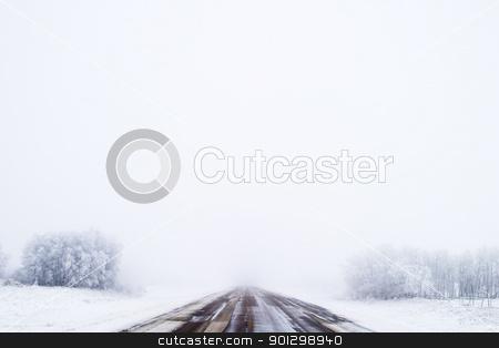 Prairie Road in Fog stock photo, Prairie highway on a foggy day. by Tyler Olson
