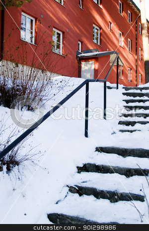 Snow Covered Stairs stock photo, Stairs going up to an appartment block, covered in snow. Oslo, Norway. by Tyler Olson