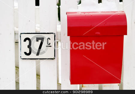 Red Mail Box stock photo, A retro mail box hanging on a white picket fence in Oslo Norway by Tyler Olson