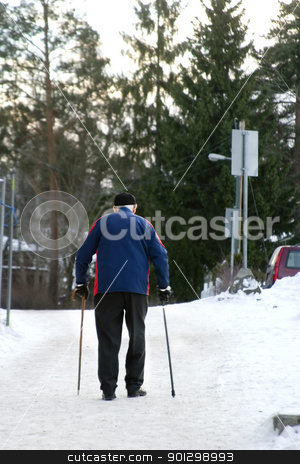 Winter Stroll stock photo, An old man walking on a snowy road with two canes by Tyler Olson