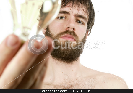 Fresh New Idea stock photo, A concept image displaying a young bearded male, holding a light bulb. Fresh New Idea. by Tyler Olson