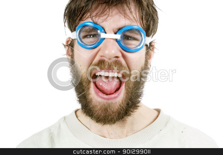 Humorous Disgust stock photo, A funny looking young male with a beard and swimming goggles looking discusted or angry. by Tyler Olson