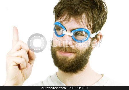 Funny Idea stock photo, A funny looking young male with a beard, thinking of a good idea. by Tyler Olson