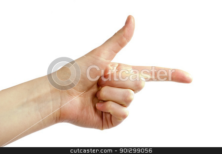 Hand Gun stock photo, An adult female hand pointing with the thumb in the air, making a gun shape. Image includes a clipping path. by Tyler Olson