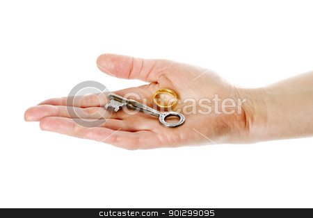 Key in Hand stock photo, A concept image of a womans hand holding a key and a wedding ring on an open palm. Isolated on white with clipping mask. by Tyler Olson