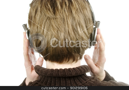 Headphones stock photo, The back of a person head who is listening to music with large earphones.  Isolated on white with clipping path. by Tyler Olson
