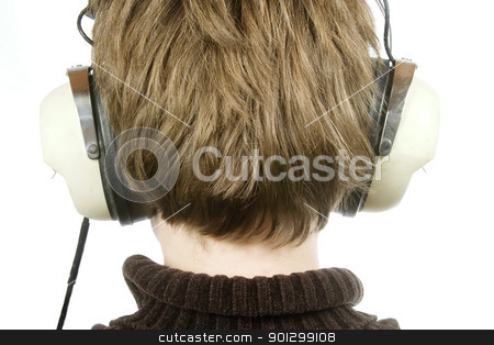 Headphones stock photo, The back of a persons head who is listening to music with large retro earphones.  Isolated on white with clipping path. by Tyler Olson
