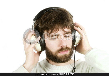 Music stock photo, A young male with a beard listening to music on large retro headphones. Isolated on white with clipping path. by Tyler Olson