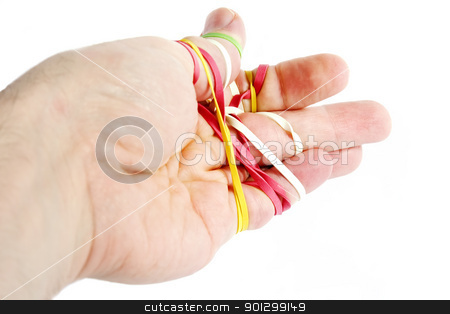 Rubber Band Tangle stock photo, A male hand tangled in a mess of rubber bands.  Isolated on white with clipping path. by Tyler Olson