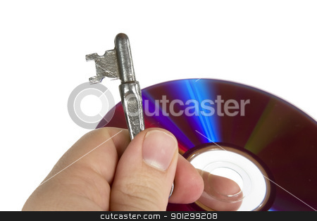 Data Security stock photo, A skeleton key and a computer disk being held by a males hand, isolated on white with clipping path. by Tyler Olson