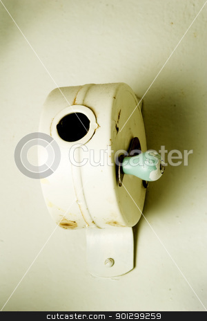 Hanger Abstract stock photo, Clothes hanger rope dispenser abstract. by Tyler Olson