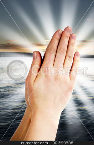 Power of Prayer stock photo, Praying hands with a landscape with the ocean and a sunset in the background by Tyler Olson