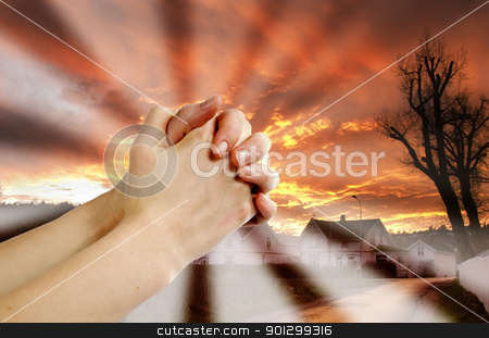 Prayer Warrior stock photo, Hands praying with a dramatic red sky overa small town; prayer warrior. by Tyler Olson