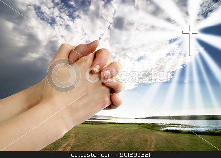 Prayer Warrior stock photo, A pair of hands in a praying position set against a beautiful prairie lake landscape with a cross in the sky on the right side. by Tyler Olson