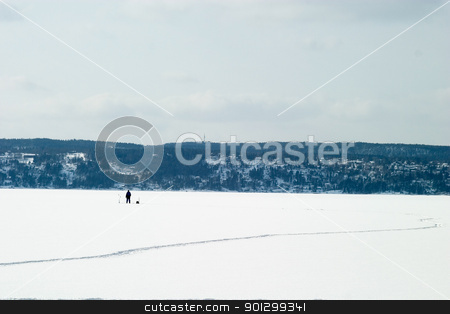 Ice Fishing stock photo, A person Ice fishing on the oslo fjord in early March. by Tyler Olson