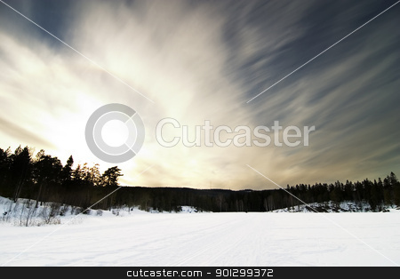 Dramatic Landsacpe stock photo, A dramatic landscape on a frozen lake. by Tyler Olson