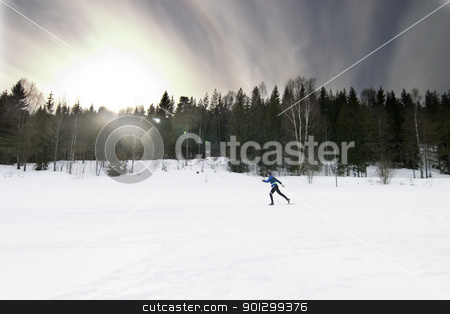 Skiing stock photo, Skiing on a bright sunny day.  A winter landscape looking into the sun with lens flare. by Tyler Olson