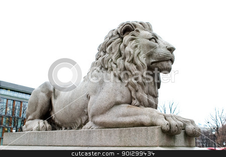 Lion Statue stock photo, A lion statue sits majesticaly on it's pedestal. by Tyler Olson