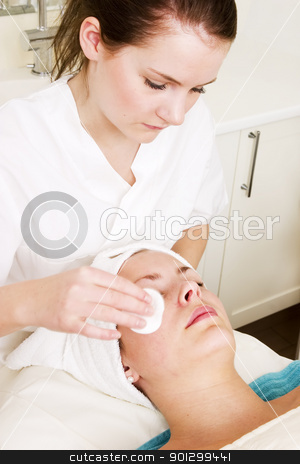 Spa Facial stock photo, Lotion being massaged of the face at a beauty spa during a facial by Tyler Olson