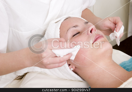 Beauty Spa Facial stock photo, Lotion being wiped off during a facial at a beauty spa. by Tyler Olson