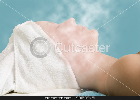 Facial Steam Treatment stock photo, Relaxing during a facial steam treatment at a beauty spa. by Tyler Olson