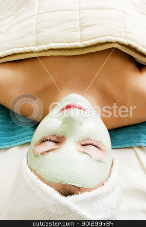 Facial Mask Relaxation stock photo, Relaxing with a green apple facial mask at a beauty spa. by Tyler Olson