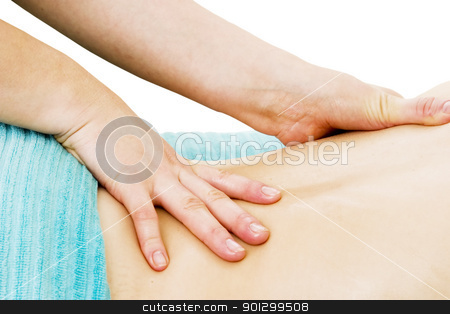 Spa Massage stock photo, A female receives a lower back massage at a day spa. by Tyler Olson