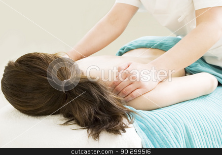 Shoulder Massage stock photo, Shoulder massage detail at a beauty spa. by Tyler Olson