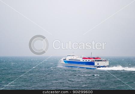 Speed Ferry on Ocean stock photo, A speed ferry catamaran on the Ocean by Tyler Olson