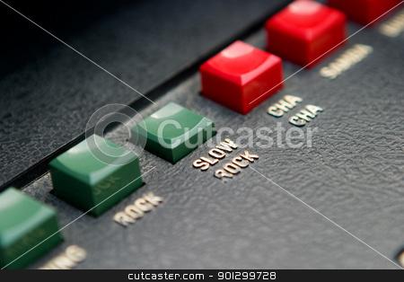 Retro Rock Button stock photo, Retro organ button with Rock in focus by Tyler Olson