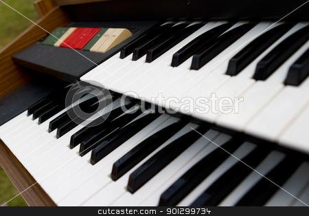 Retro Organ keys stock photo, detail of an old retro organ by Tyler Olson
