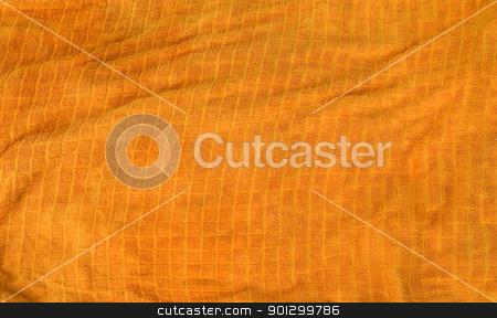 Orange Towel Texture stock photo, A bright orange cloth towl background texture by Tyler Olson