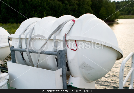 Life Raft stock photo, A life raft on the side of a boat ready for deployment by Tyler Olson