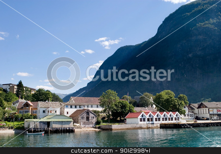 Mountain Village in a Fjord stock photo, Otternes Village viewed from Aurlandsfjord which is part of Sognefjord, Norway. by Tyler Olson