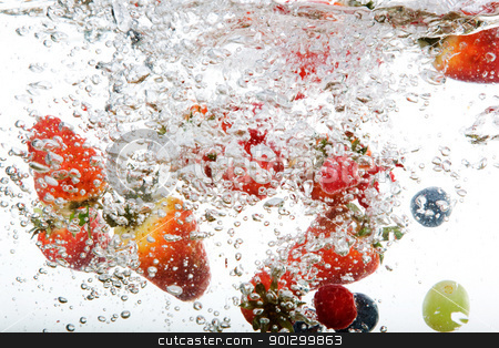 Fresh Fruit in Water stock photo, Fresh fruit background in water over white by Tyler Olson