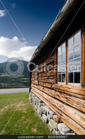 Old Norwegian Log Building stock photo, An old log building detail in Norway by Tyler Olson