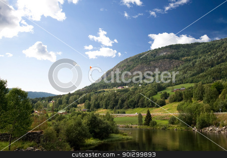 Norwegian Landscape with Parachute stock photo, A Norwegian mountain landscape with a parachute in the sky by Tyler Olson