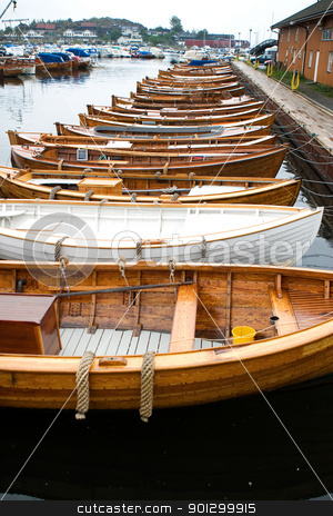 Old Norwegian Boats stock photo, A row of old norwegian boats at Stavern, Norway by Tyler Olson