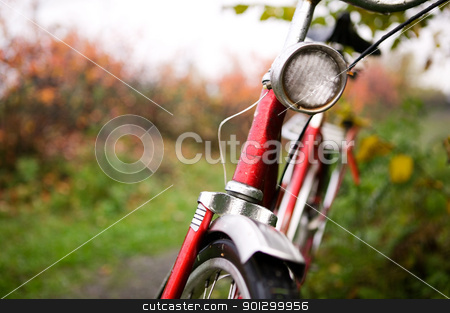 Retro Bike Detail stock photo, An old red bike detail with a shallow depth of field on a rainy autumn day. by Tyler Olson
