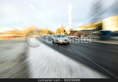 Speeding Car stock photo, Zoom blur of a speeding car on a urban road by Tyler Olson