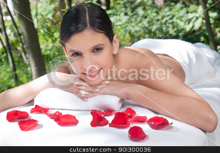 Beautiful young woman relaxing stock photo, Beautiful young woman relaxing at spa in a natural setting by Tyler Olson