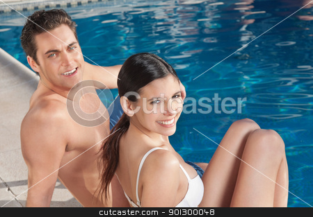 Beautiful young couple relaxing by the poolside stock photo, An beautiful young couple relaxing by the poolside by Tyler Olson