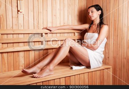 Beautiful young woman relaxing stock photo, Beautiful young woman relaxing in a finish sauna by Tyler Olson