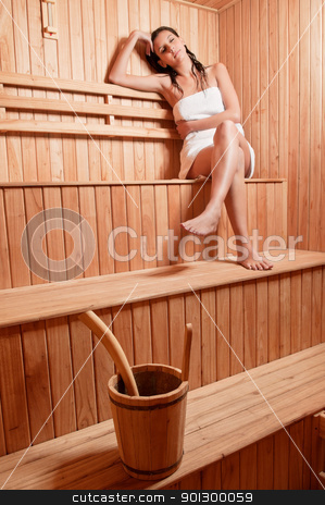 Young woman relaxing stock photo, Beautiful young woman relaxing in a finish sauna by Tyler Olson