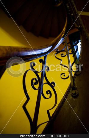 Antique Stairwell Railing stock photo, An abstract image of an old stairwell and railing with decorative iron. by Tyler Olson