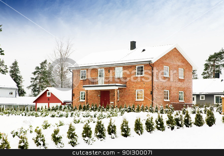 Large Brick House stock photo, A large brick house in a nice neighborhood surrounded by bushes. by Tyler Olson