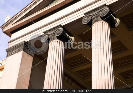 Greek Ionic Column stock photo, A detail of an old building built in the old Greek style with Ionic columns. by Tyler Olson