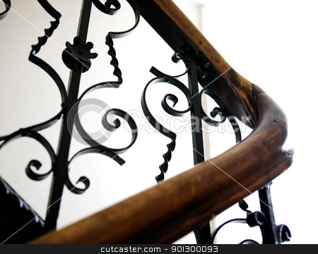 Antique Railing Detail stock photo, An old railing in a european apartmant building. by Tyler Olson