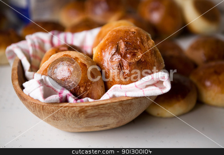 Hot Cross Buns stock photo, Close up detail of freshly baked hot cross buns in romantic renaissance lighting and a shallow depth of field. by Tyler Olson